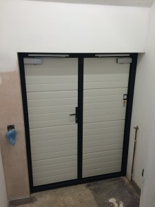 Side hinged garage doors installed by Byron Doors in Finchley, London.